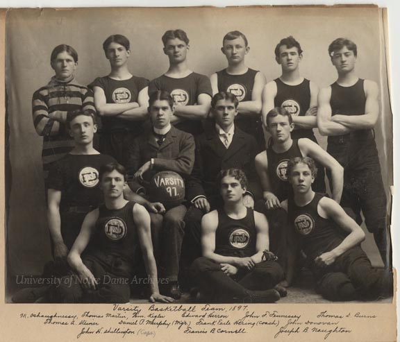"""Varsity Basketball Team, 1897, with Frank E. Hering as coach (middle row, second from right).  For an unknown reason, there is a frog on the knee of the player in front of him."" - University of Notre Dame Archives"
