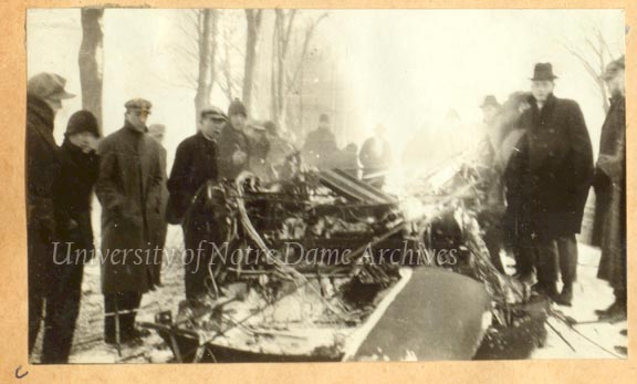 Students gathered around the burned out Hill Street car, February 1916.