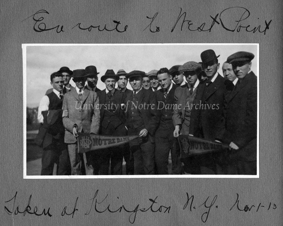 Football team members and boosters in Kingston, New York en route to West Point, 1913/1101. Including Ray Eichenlaub, Charles (Gus) Dorais, George (Hullie) Hull, Art (Bunny) Larkin, Keith (Deac/Deak) Jones, Joe, Gush (Fred Gushurst?), Em (Emmett Keefe?), Charles (Sam) Finegan, Paul (Curly) Nowers, Allen (Mal) Elward, Knute Rockne, and Mike Calnon.