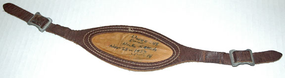 Chin strap worn by player Nick Raich in the Notre Dame vs. Southern California (USC) football game, 1953/1128