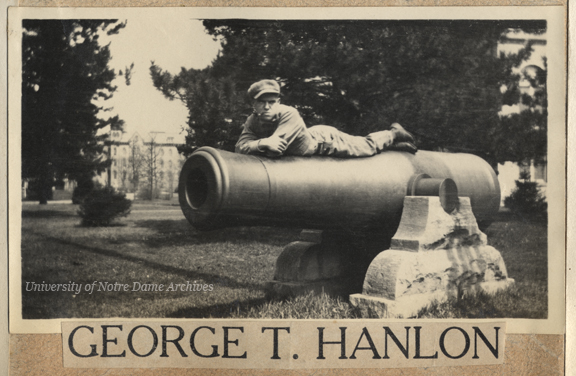 George T. Hanlon laying on a cannon on Main Quad, c1910s.