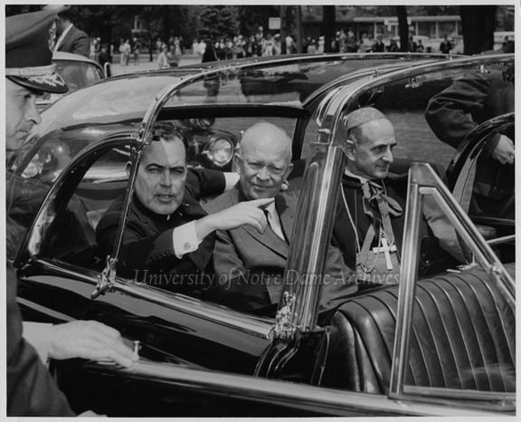Commencement - Rev. Theodore M. Hesburgh, President Dwight D. Eisenhower, and Cardinal Giovanni Battista Montini sitting in the back seat of a car at Notre Dame, 1960/0605.