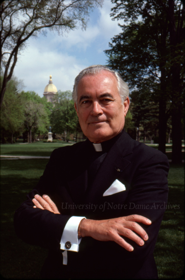 "Portrait of Rev. Theodore M. Hesburgh, CSC, outside with the Main Building Dome in the background, May 1980. Photo by Bruce Harlan.  This photo was used on the cover of ""God, Country, Notre Dame."""