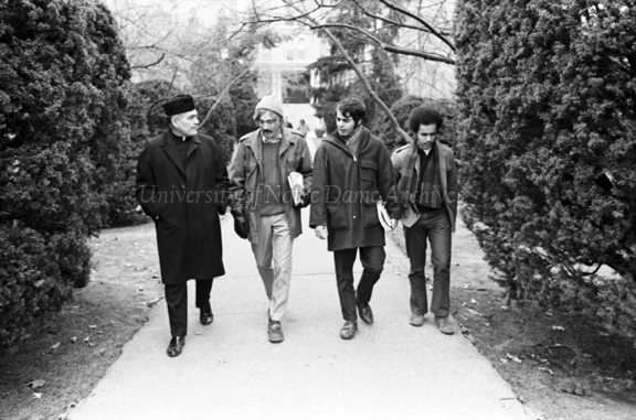 Rev. Theodore M. Hesburgh walking with members of the Student Government, December 1970.  The student on the far right is Dave Krashna, Student Body President.  The middle student is unidentified and the student next to Hesburgh is Mark Winings, Student Body Vice President.