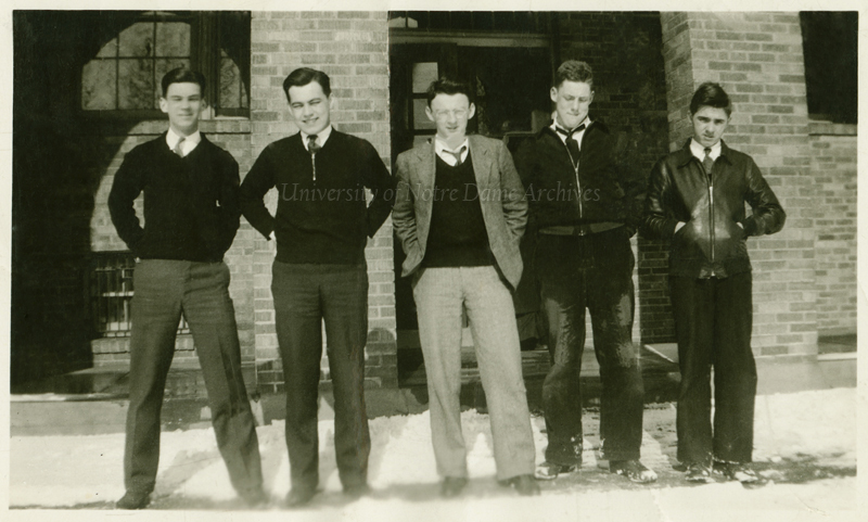 Rev. Theodore M. Hesburgh, CSC (second from left), as a seminary student, with other students, in front of Holy Cross Hall in winter with snow, 1935.  The 1934-1935 school year was Hesburgh's first at Notre Dame.
