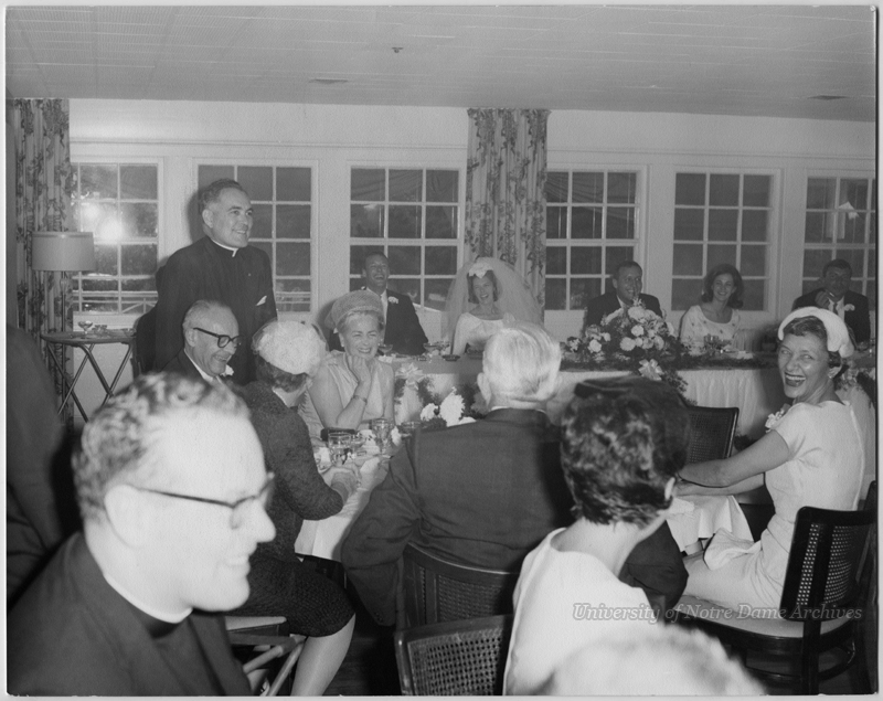 Rev. Theodore M. Hesburgh at an unidentified wedding reception, c1965.